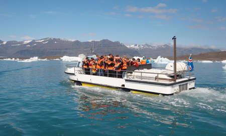 jokulsarlon: Icelandic landscape with amphibian vehicle, icebergs and lake