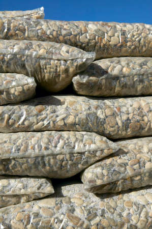 Packaged and stacked stones for industry  Vertical format photo