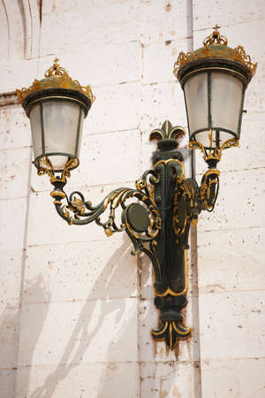 Antique outdoor lamp in green and golden tone  Vertical format photo