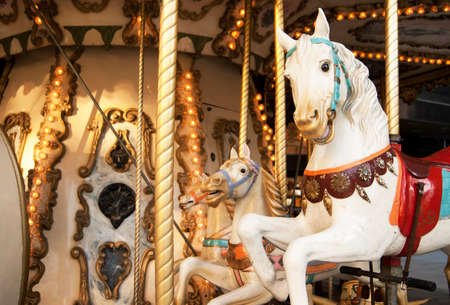 Merry-go-round with horses in warm tone  Horizontal format photo