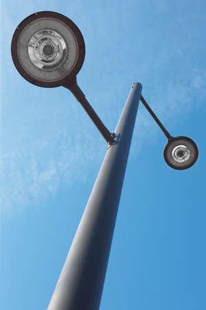 Modern street lamp under a blue sky  Vertical format 版權商用圖片