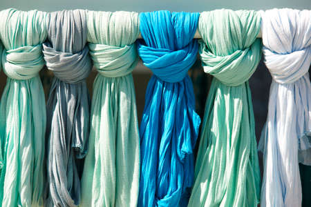 green and blue ladies scarves in a tourist shop. Crete. Greece. Horizontal