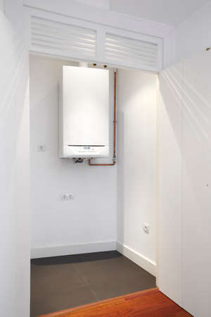 House boiler room with white walls. Vertical format photo