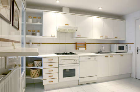 horizontal format: Apartment kitchen interior in white tone. Horizontal format