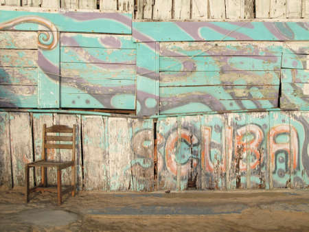 oldtown: Rusty wooden facade with scuba diving Stock Photo