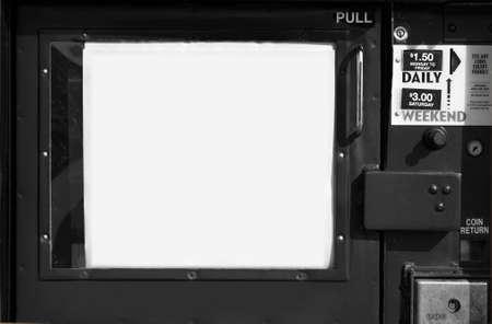 Newspaper box machine in black and white. Horizontal