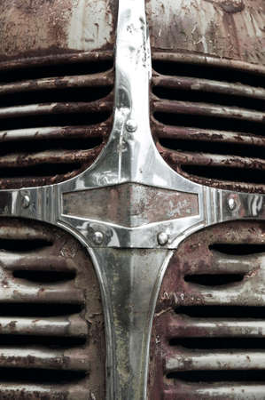 vertical format: Rusty abandoned automobile grill in vertical format. Front Stock Photo