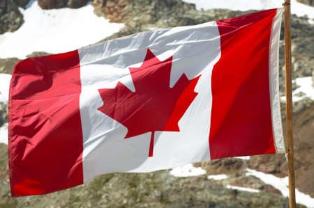 canadian flag: Canadian flag with mountain background. British Columbia. Canada. Horizontal