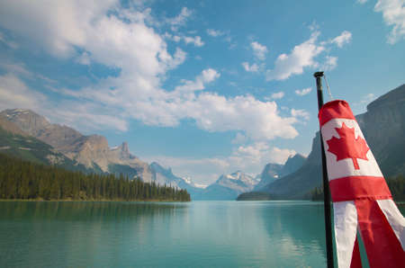 Canadian landscape with mountains, Maligne lake and flag. Alberta. Horizontal 版權商用圖片