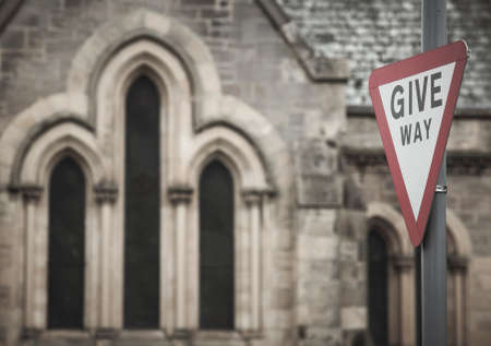 give the way: Scottish cathedral detail with traffic signal. Give way