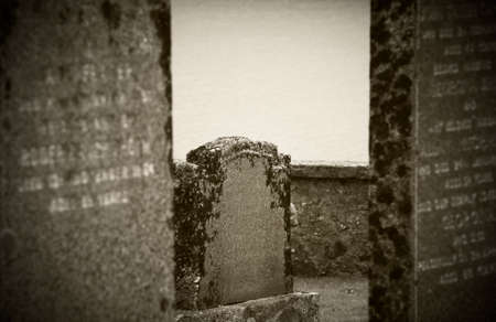 ness: Scottish graveyard and Loch Ness in sepia tone. Horizontal Stock Photo