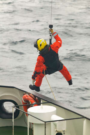 coastguard: Coastguard rescue team in action. Scotland. UK. Vertical