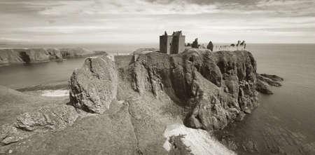 dunnottar castle: Dunnottar castle ruins in scottish coastline. Stonehaven. Scotland. UK. Horizontal