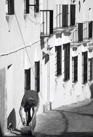 spanish homes: Worker in a traditional spanish rural village in Cadiz. Spain. Vertical