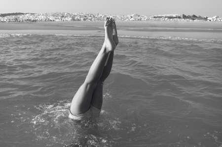 headstand: Girl doing a headstand on the beach. Cadiz. Spain