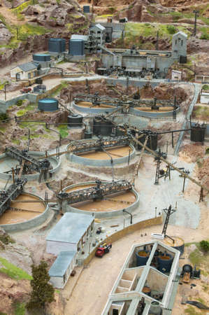 gold mining: Old gold mining exploitation method miniature model. Vertical format Stock Photo