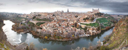 Toledo panoramic view at sunset with Tajo river in Spain. Horizontal Stock Photo