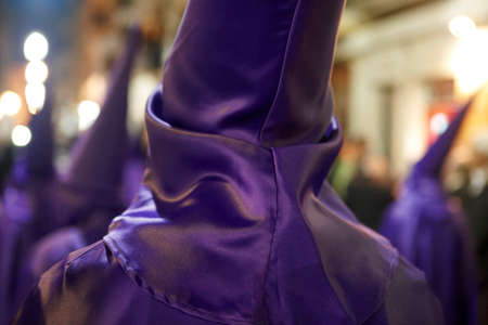 holy thursday: Holy week, easter time in Spain. Nazarenos in purple dress. Horizontal