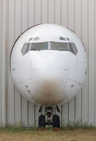 nose close up: Aircraft nose in an industrial plant facade in vertical format