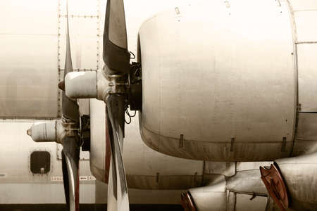 aircraft rivets: Old aircraft propeller engines airframe and blades in warm tone. Horizontal