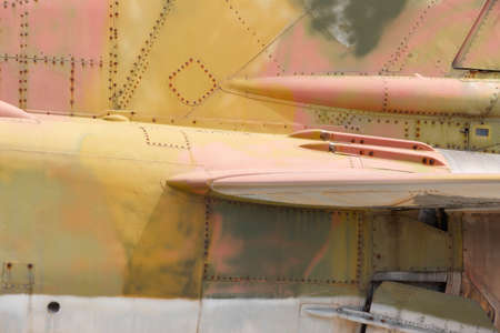 horizontal format: Fighter aircraft rusty fuselage detail in horizontal format