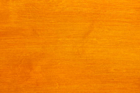 Varnish piece of wood in warm tone in horizontal format photo