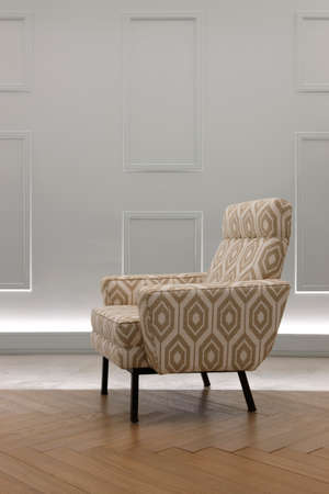 vertical format: Armchair in a living room with grey wall. Vertical format Stock Photo