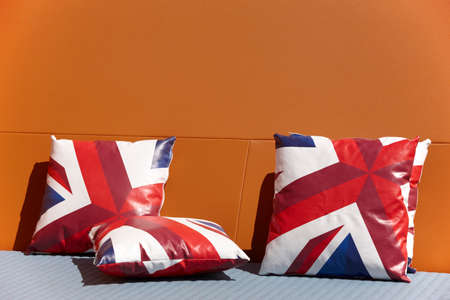 chill out: Chill out zone with british colors cushions and orange wall. Horizontal