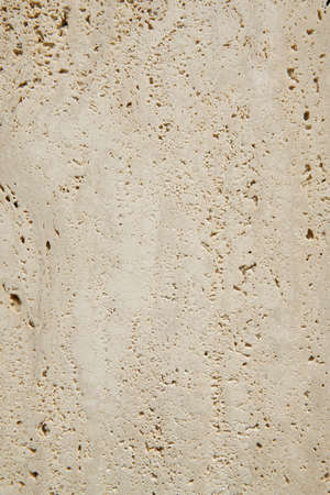 travertine house: Travertine marble surface detail in vertical format. Indoor