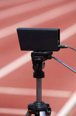 photoelectric: Athletic finish line photoelectric cell control device and running track. Vertical