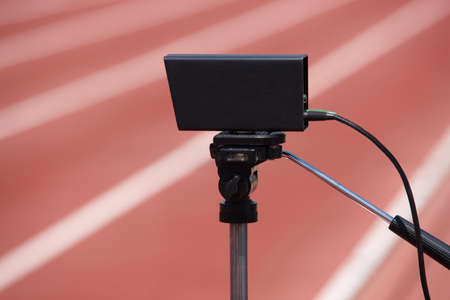 photoelectric: Athletic finish line photoelectric cell control device and running track. Horizontal