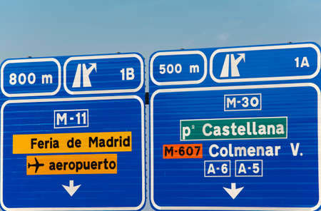 direction signs: European spanish information road highway signpost in blue tone. Horizontal