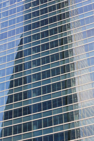 financal: Skyscraper facade glass reflection in a financal area, Madrid. Vertical