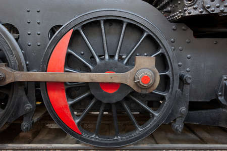 connecting rod: Steam locomotive wheel and connecting rod detail. Black and red. Horizontal
