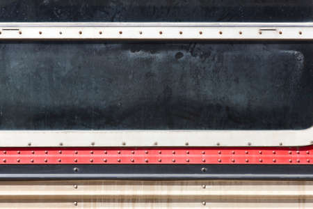 horizontal format: Antique train window with worn parts in horizontal format