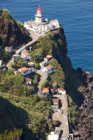 atlantic ocean: Lighthouse, road and atlantic ocean in Ponta do Arnel, Azores. Vertical