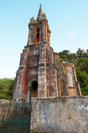 canto: Neogothic chapel in Furnas lake. Sao Miguel. Portugal. Vertical