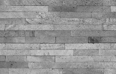 porous brick: Volcanic stone bricks wall background in black and white. Horizontal Stock Photo
