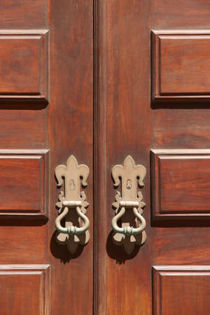 vertical format: Antique entrance wooden classic doors with metallic locks. Vertical format Stock Photo