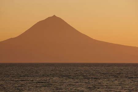 jorge: Azores landscape. Pico mountain view from Sao Jorge island. Portugal. Horizontal Stock Photo