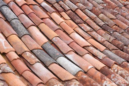 horizontal format horizontal: Old clay tile roof detail in horizontal format. Warm tone Stock Photo