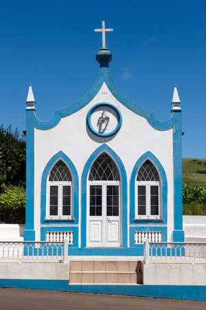 catholic chapel: Traditional Azores catholic chapel in Santo Antao. Sao Jorge. Portugal. Vertical Stock Photo