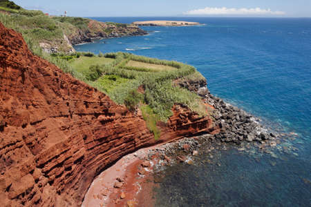 portugal agriculture: Azores coastline landscape with red cliffs in Topo. Sao Jorge. Horizontal