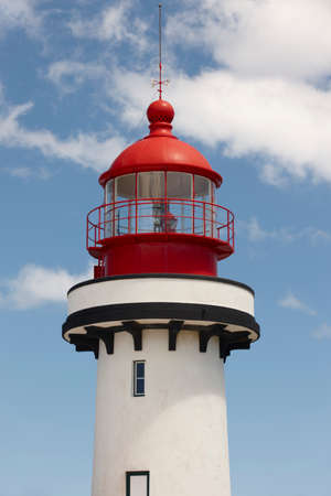 jorge: Red and white lighthouse in Topo, Sao Jorge, Azores. Portugal. Vertical Stock Photo