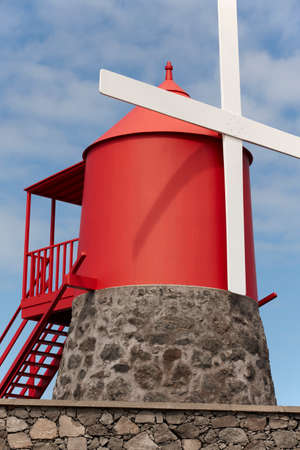 rotational: Traditional red and white windmill in Pico island, Azores. Portugal. Vertical Stock Photo