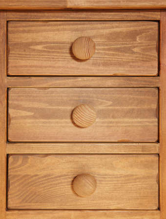 vertical format: Rustic wooden drawer in warm tone. Vertical format. Brown color