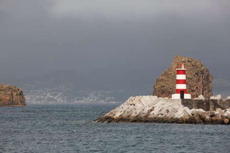 madalena: Coastline landscape with lighthouse. Madalena port. Pico island. Azores, Portugal. Horizontal Stock Photo