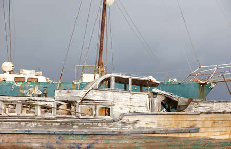 scraping: Rusty wooden sailboat waiting to be scraping in Azores. Portugal. Horizontal