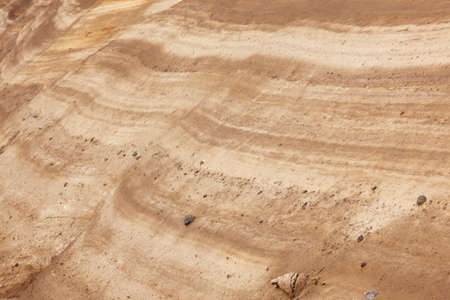 mud pit: Ground layers with rocks in perspective. Warm tone. Horizontal Stock Photo