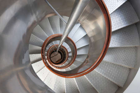 handrails: Metallic spiral stair with wooden handrails inside a lighthouse. Horizontal